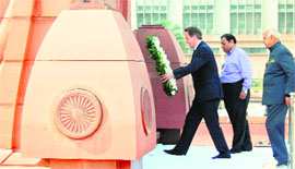 ritish Prime Minister David Cameron lays a wreath at Jallianwala Bagh.