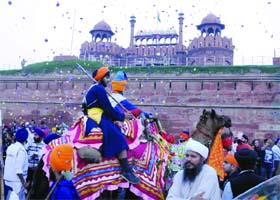 Sikh devotees take part in a procession on the occasion of the Fateh Diwas near Red Fort In Delhi on Sunday.