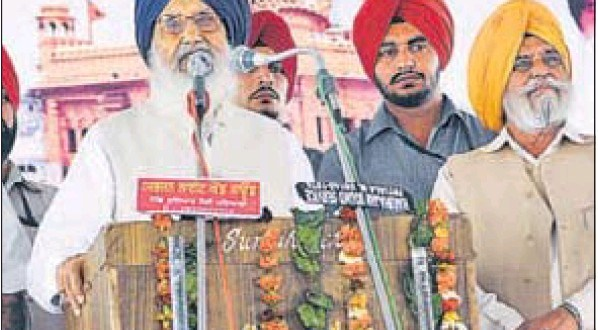 Chief minister Parkash Singh Badal addressing a gathering on the death anniversary of jathedar Gurcharan Singh Tohra at his native village, Tohra, in Patiala district on Tuesday.
