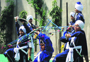 Students perform gatka during the visit of delegation from Northfield Mount Hermon School on the campus of International Fateh Academy in Amritsar