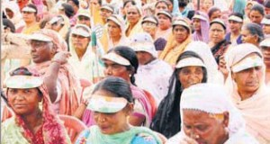 Women wearing caps with Congress slogans during a rally in Bathinda