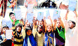 Slum children release a book related to Gurbani in Ludhiana