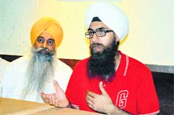 Amarbeer Singh Gill (right) interacts with mediapersons in Ludhiana.