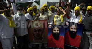 1307281443-bjp-workers-protest-against-arrest-of-baba-ramdev-amritsar_715914