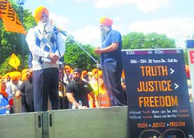 Dal Khalsa head Harcharanjit Singh Dhami addresses a gathering at a function to mark 30th anniversary of Operation Bluestar in the UK.