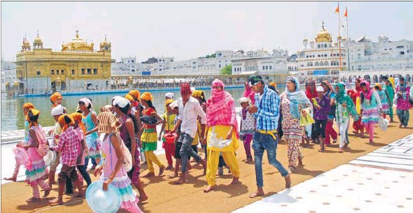 Devotees at the Golden Temple in Amritsar on Saturday, a day after two groups clashed on the premises.