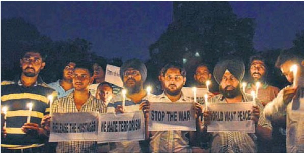 (From left) Families of youths stranded in Iraq, at the Golden Temple; activists of various NGOs taking out a candlelight march for the safe return of Indians, in Amritsar