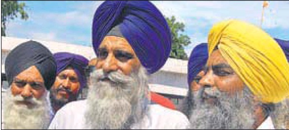 Haryana Sikh leader Jagdish Singh Jhinda (centre) after a meeting at Dera Kar Sewa in Kurukshetra