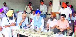 Officials of the district administration along with SAD leaders meeting villagers ahead of the Chief Minister's Sangat Darshan in Muktsar district