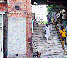A view of the newly cemented portion of Maharaja Sher Singh Gate where a plaque was installed earlier at Golden Temple