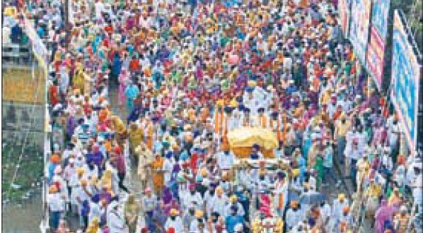 Guru Granth Sahib being carried in a palanquin through Batala on Monday to celebrate Babe Da Viah.
