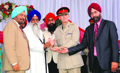 Members of the British Army are honoured by Jathedar, Akal Takht, Giani Gurbachan Singh, and former Army chief Gen JJ Singh at the Battle of Saragadhi commemoration event near Amritsar