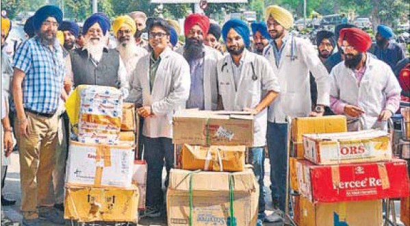 SGPC president Avtar Singh Makkar (second from left) with a team of doctors leaving for Srinagar; and (right) evacuees break down after meeting their kin at Sri Guru Ram Dass Jee International Airport in Amritsar
