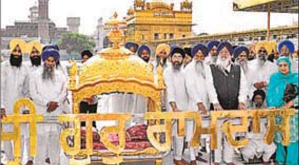 SGPC president Avtar Singh Makkar and others with a golden palanquin (palki) donated by a devotee at the Golden Temple in Amritsar