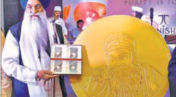 Akal Takht jathedar Gurbachan Singh unveiling a gold coin ahead of the birth anniversary of Guru Nanak Dev in Amritsar.