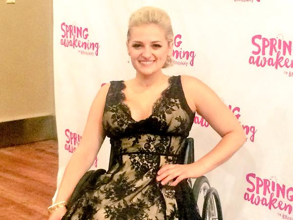 Ali Stroker is a graduate of New York University and the first person in a wheelchair to graduate from Tisch's drama program.