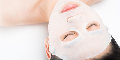 woman with cloth facial mask
