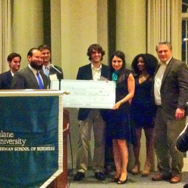 Members from Tulane Entrepreneurs Association presenting the $25,000 check to Tympanogen at the 2014 competition. Photo by @neworleansbio.