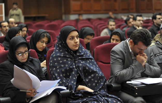 Iranian Reyhaneh Jabbari, center, sits while attending her trial in a court in Tehran, Iran. AP Photo/Golara Sajjadian