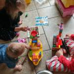 The girls are enjoying playing Duplos with Abram Grey Theyhellip