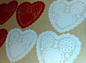 How to used paper doilies to create hanging Valentine's decorations