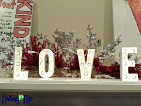 You can use holiday decorations on clearance to decorate for the next holiday like this Valentine's mantel.