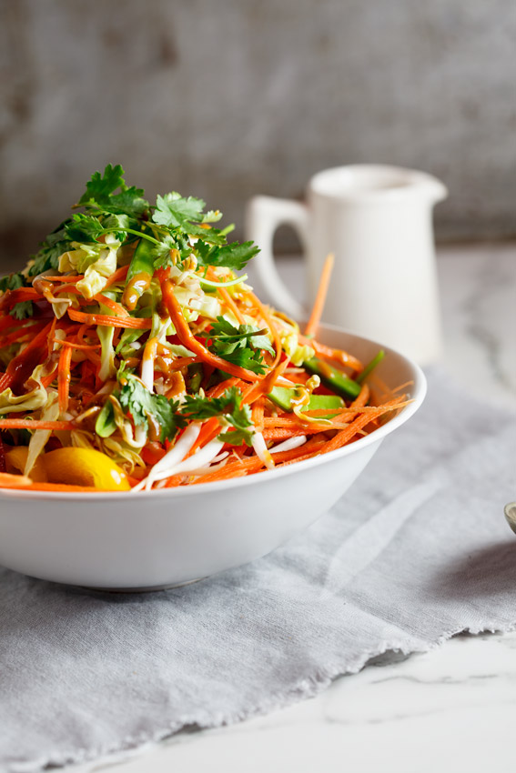 Asian shredded chicken salad with spicy peanut dressing