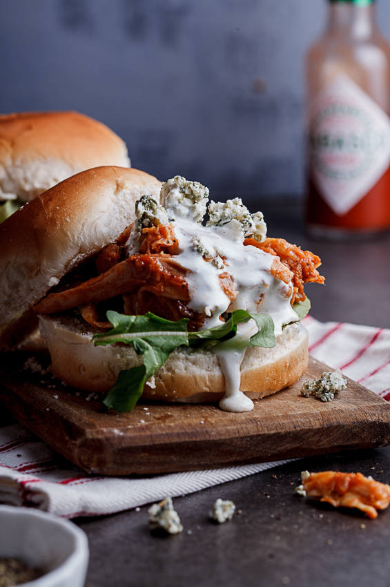 Buffalo chicken sliders with blue cheese sauce