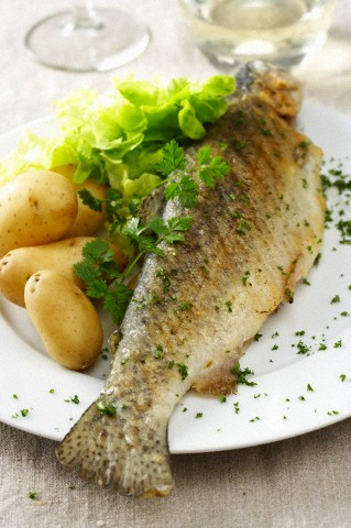 Fried trout with boiled potatoes and lettuce