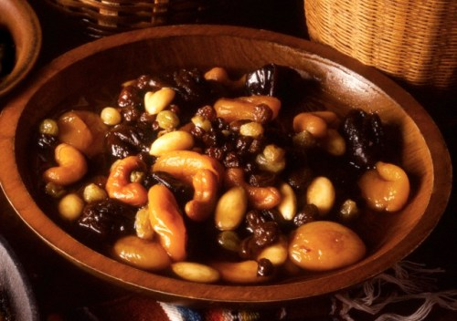 Toasted Mixed Nuts with Poached Dried Fruit in a Wooden Bowl