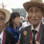 Korean War Veterans in Pyongyang | Image via Rodong Sinmun video, August 4, 2012