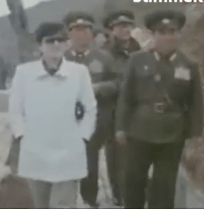 Kim Jong-un's mother, Go Young-hee, also brought black clutch purses along to on-site inspections with her husband | Image via DailyNK video footage obtained from DPRK, uploaded by StimmeKoreas