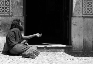 A beggar in Belém, Lisbon. He sat there for hours without moving.