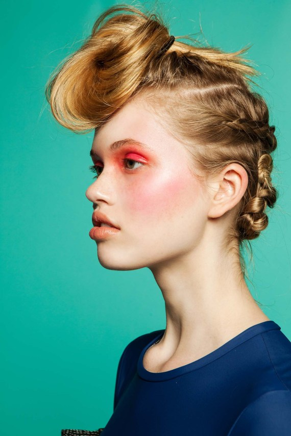 Red eye shadow look and braided hair