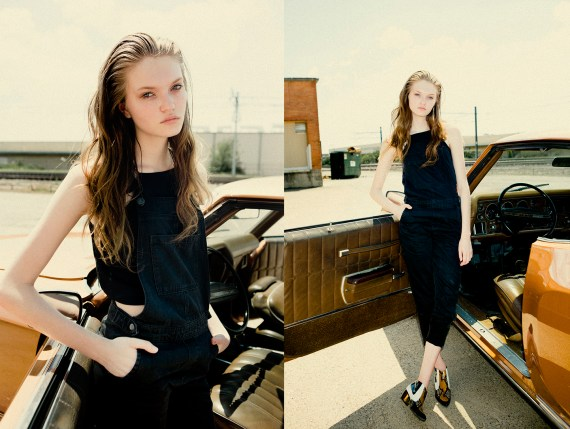 girl standing by car