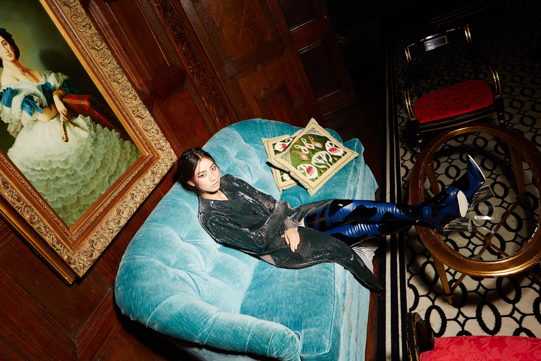 Woman sitting on a light blue love seat