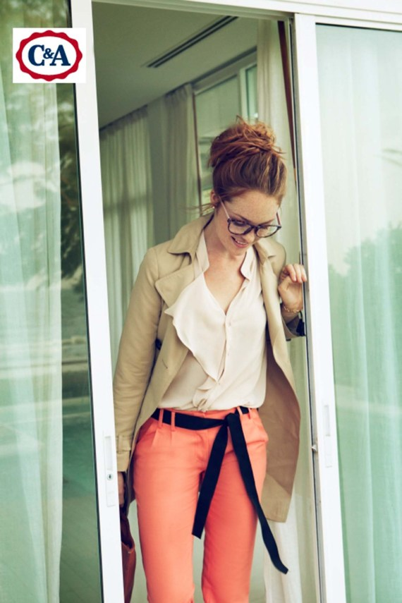 Woman walking out of an office building dressed in C&A clothing