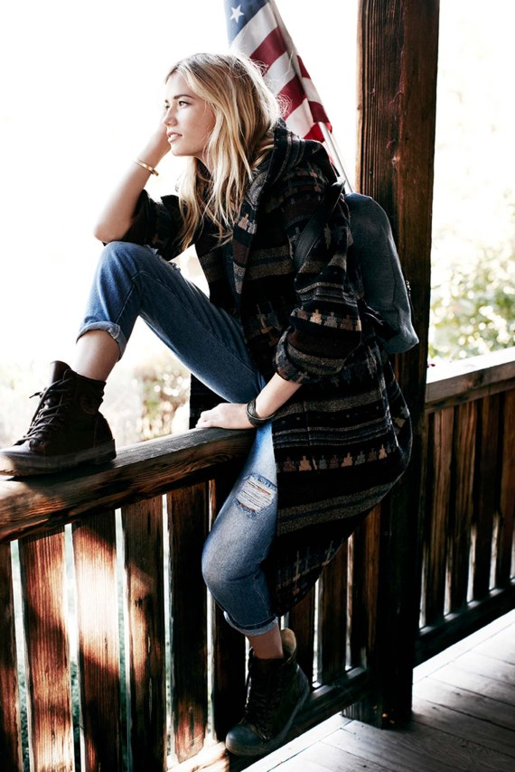 Girl sitting on wooden balcony