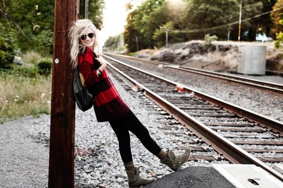 Girl Standing near railroad tracks