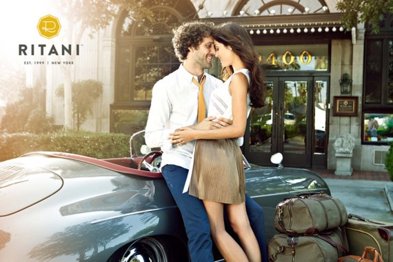 Man and woman leaning on a vintage car