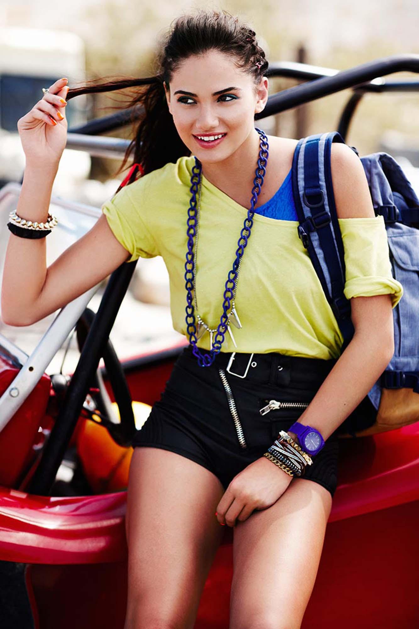 Girl sitting on a golf cart