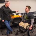Local veteran hero Adam Hartswick, who lost both legs in combat in Afghanistan, chats with Maj. Gen. Jeffrey Clark, current commander of the Walter Reed National Military Medical Center, where Hartswick was treated.