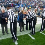 Referees greet the coin-toss participants. Military Appreciation Day, Penn State vs. Army, Oct. 3, 2015.