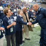 Penn State football Coach James Franklin greets one of the Wilson sisters before the coin toss. Military Appreciation Day, Penn State vs. Army, Oct. 3, 2015.
