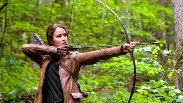 Katniss hunting in the woods