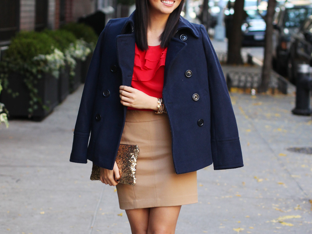Skirt The Rules Blog; NYC fashion blogger; style blog; how to wear red and navy college colors; Julie Brown red ruffle blouse; J.Crew navy wool peacoat; Express camel pencil skirt; Michael Kors tortoise watch; Forever 21 gold geometric bracelet; Gorjana and Griffin alphabet disc bracelet; C. Wonder leopard skinny cuff; Hello Fab gold sequin glam clutch; Diane von Furstenberg DVF leopard calf hair pumps