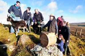 Sarah churns at the Bracket Stones for Imbolc Festival 2015