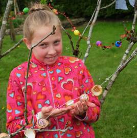 Deirbhile C Fennell shows her Egg shell Garland at the May Bush - photo Kathleen Culliton