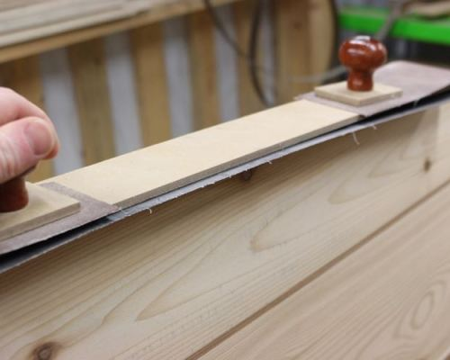 Sanding rails with fairing board