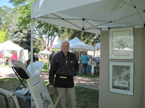 Bill Halopoff with His Exhibit at Festival of the Arts